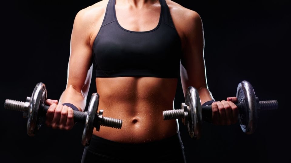 woman strengthtraining dumbells - How to Make the Best Out of Your Weight Training