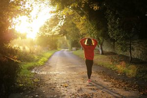 woman walking fitness nature 300x200 - Why being more physically active can improve your stomach problems