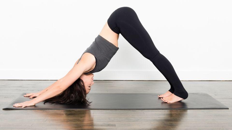 yoga downwarddog - How to Overcome Shoulder & Lower Back Soreness When Travelling