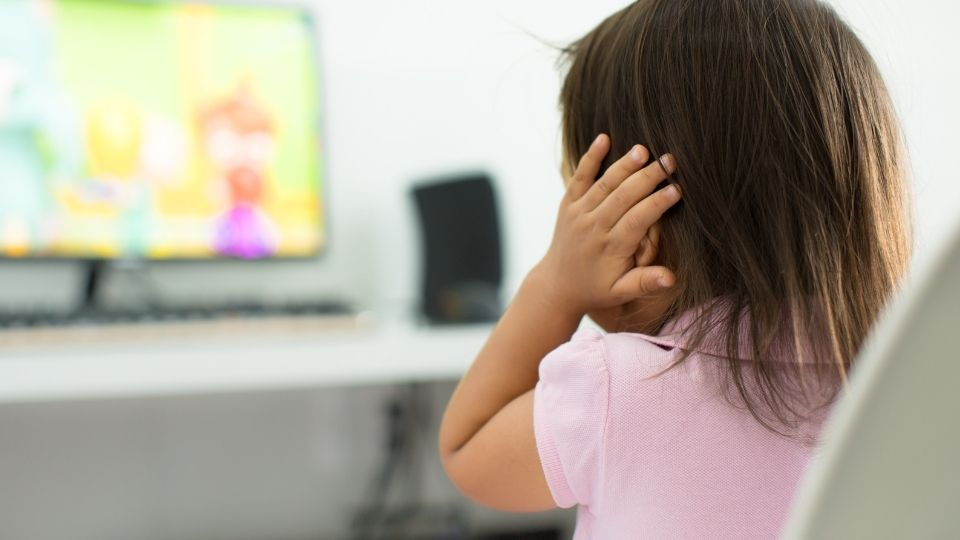girl close ears - What to do when your child have autism