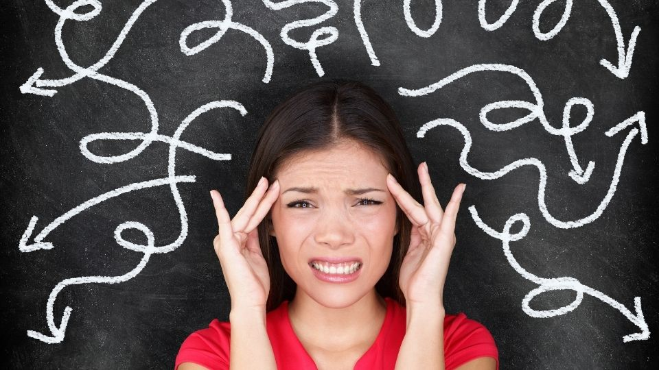 woman headache - Avoid negative people as much as you can