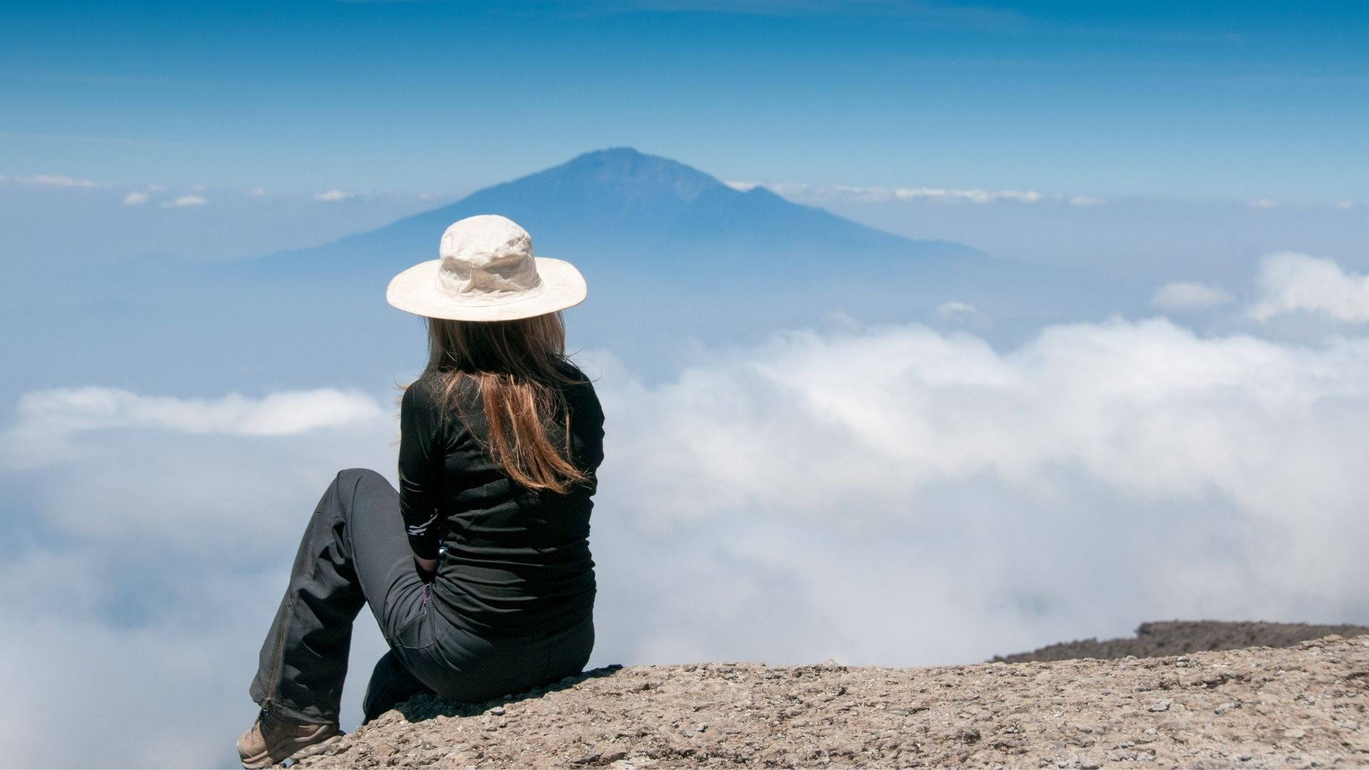 woman thinking2 - So you want to quit your job to travel?
