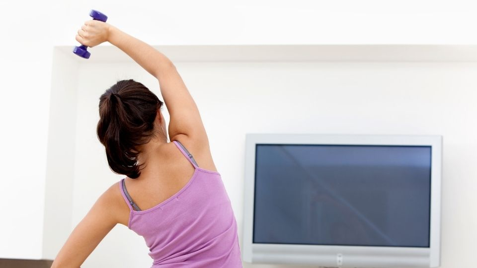 woman exercise - Quit watching TV and work towards your life and fitness goals
